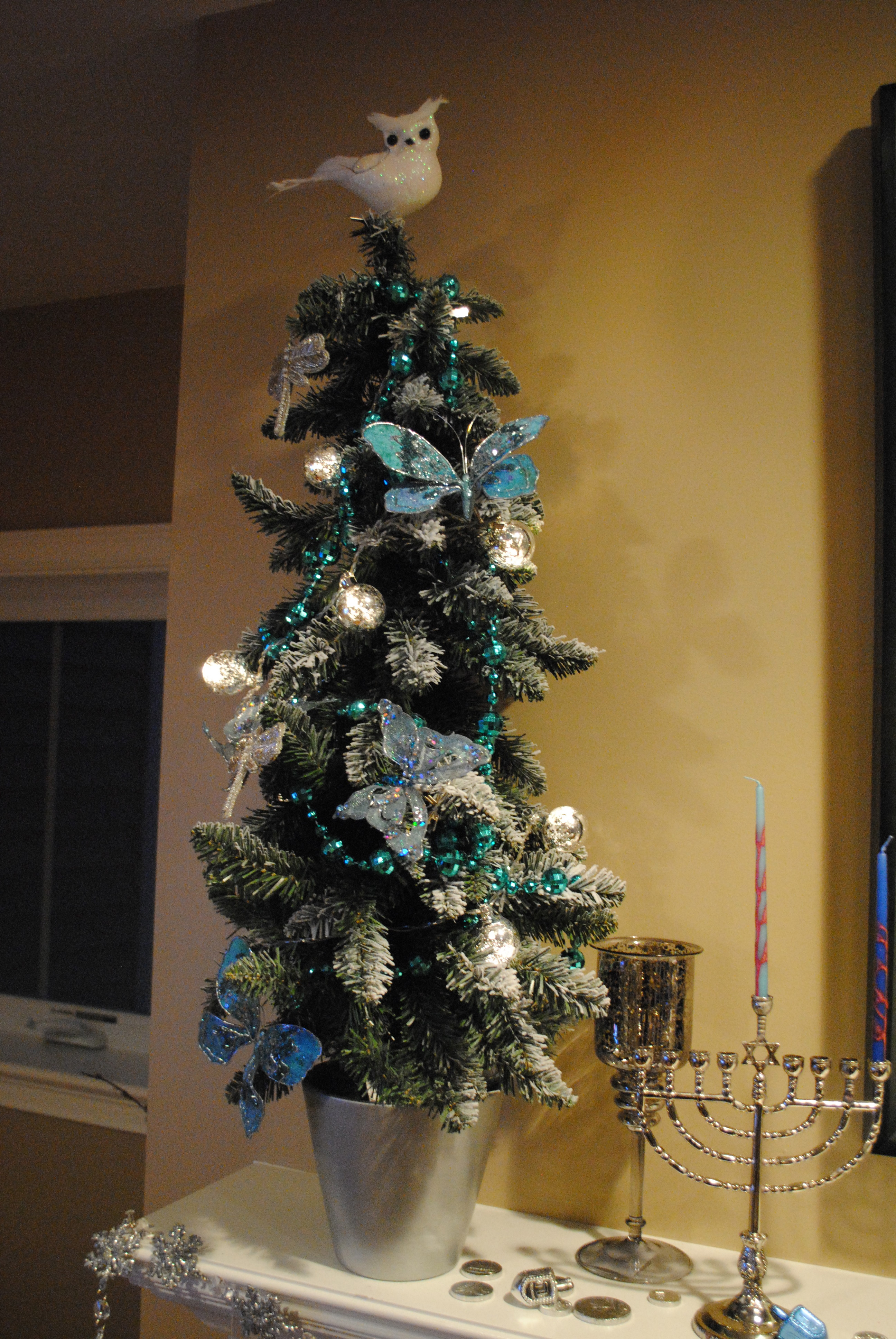 Hanukkah ornaments for a tree - We Flanked The Mantel With Two Snow Covered Trees In Silver Pots We Added The Blue Beads Some Blue And Sliver Glittery Butterflies Some Dazzling